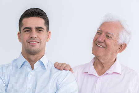 kin: Shot of an elegant senior man supporting his young son Stock Photo