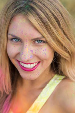 face covered: Portrait of a beautiful, young girl with her face covered with a powder paint