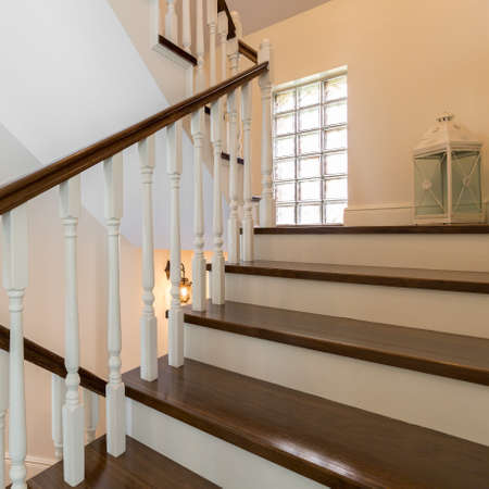 wooden stairs: Classic wooden stairs in stylish storey house