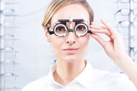 shortsightedness: Young woman with trial frame for lens determination