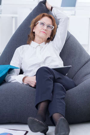 bean bag: Businesswoman lying on bean bag chair and relax