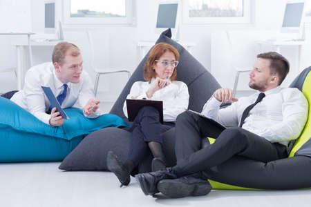 bean bag: Modern office arrangement- business meeting in bag chairs