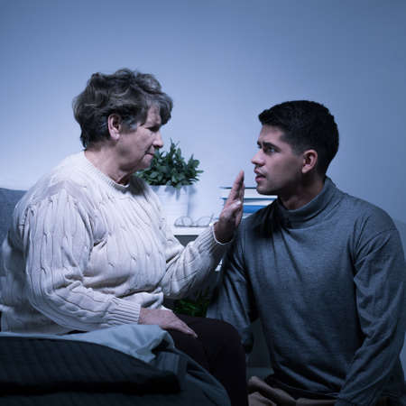 wise woman: Wise older grandmother giving advice to her grandson