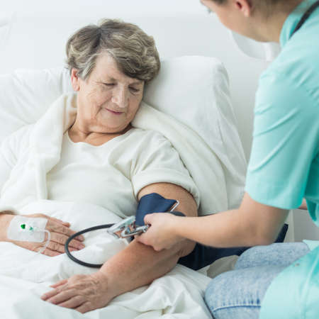 geriatric: Photo of geriatric ward patient with hypertension and nurse Stock Photo