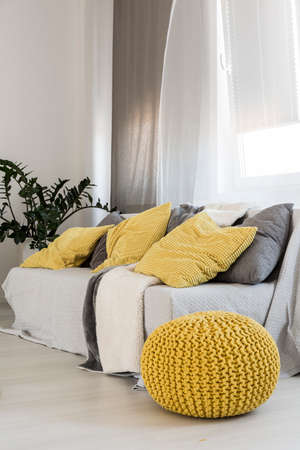 throw cushion: Shot of a modern sofa with yellow and gray decoration elements