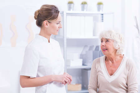 orthopedist: Senior woman during consultations at orthopedists office Stock Photo