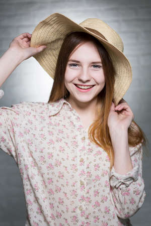 countenance: Portrait of smiled, long haired and blue-eyed girl, having a carteheel hat Stock Photo