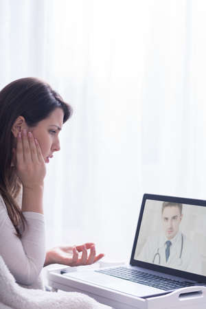 computers online: Woman getting an advice from her doctor on-line