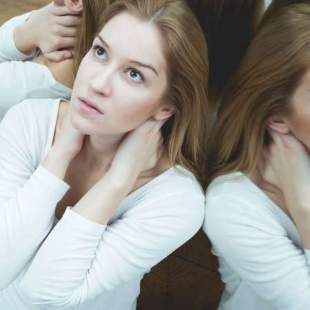 Young pretty scared sick woman with anxiety Stock Photo