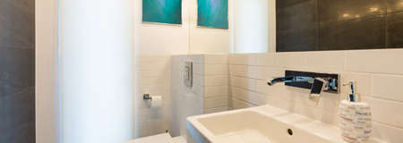 toilet sink: Bathroom interior with toilet, sink and bright backlight Stock Photo