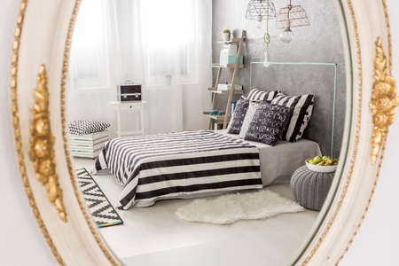 mirror frame: Mirror reflection of a contemporary bedroom, round mirror with white stylish frame