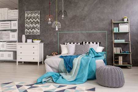 bedroom furniture: Light bedroom with modern furniture and decorative wall finish Stock Photo