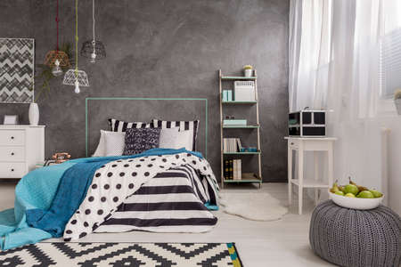 bedroom wall: Beautiful bedroom with window, comfortable bed and decorative wall finish