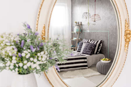 mirror frame: Mirror reflection of a new design bedroom, stylish round mirror with white frame