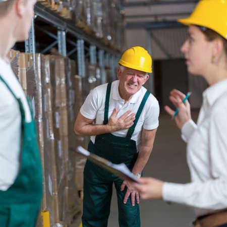 warehouseman: Older warehouseman having a painful infarction