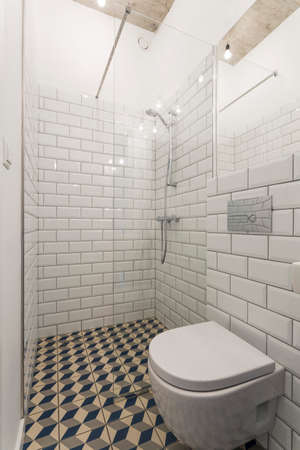 ceramic: Modern bathroom with walls decorated with brick-resembling white tiles and a glass shower enclosures
