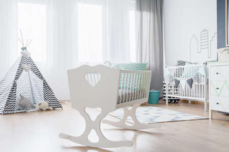 soft toys: Bright baby room with stylish cradle and teepee with soft toys