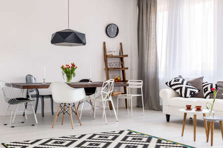 solid wire: Stunning dining and living room arranged in black and white with exclusive furniture and unique decorations