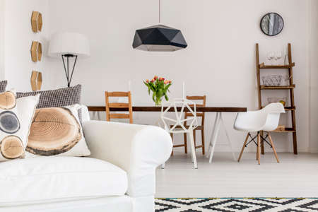 solid wire: White sofa with pillows resembling wood patterns in a stylish contemporary apartment