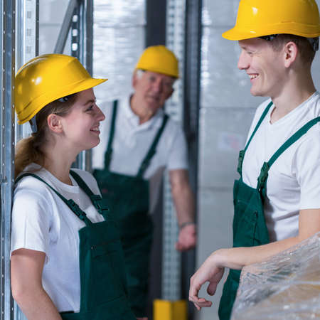 warehouseman: Young handsome warehouseman flirting with his colleague in work