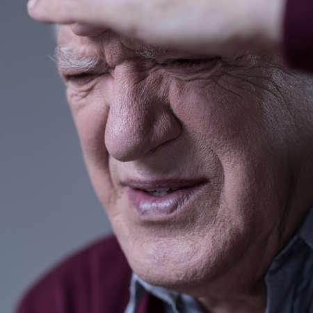 suffering: Portrait of suffering man having sinus pain Stock Photo
