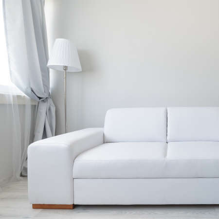 modern apartment: Close up of white comfortable leather double sofa