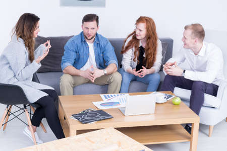 enthusiastic: Shot of a group of friends having a discussion in a room