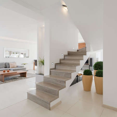 Minimalistic spacious house interior with two floors Stock Photo