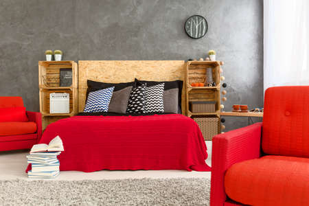 bedroom wall: Wooden crates in creative bedroom with concrete wall