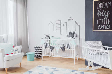 cosy: Cosy baby room with a cod, cradle and armchair Stock Photo