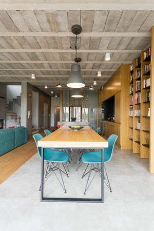 spacious apartment: Very spacious dining room joined with living room in post industrial style, with concrete ceiling Stock Photo