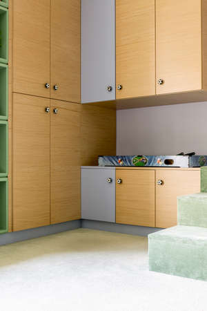 schoolboys: Corner of a schoolboys room with a large wardrobe and cabinets