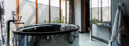 free standing: Free standing bath in silver shiny bathroom interior