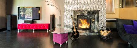 shiny black: Black brocade floor and silver shiny fireplace idea