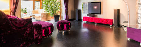 hassock: Shiny living room with purple and pink furniture Stock Photo