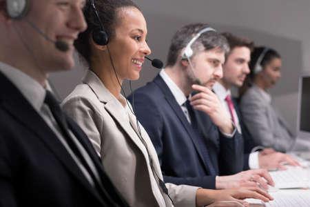 service desk: Service desk consultant talking on hands-free phone