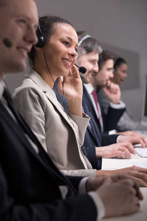 handsfree telephone: Call centre operators with headset in front of computer