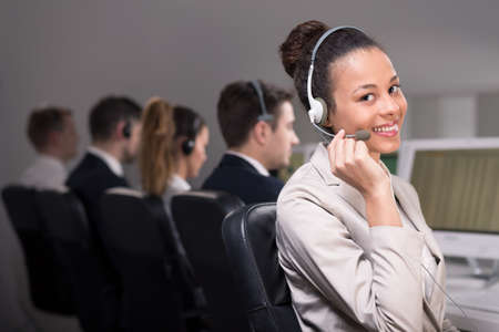 handsfree telephone: Smiling female call center agent with headset