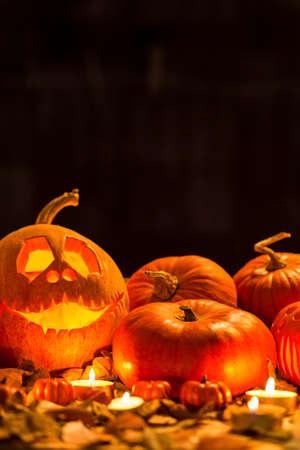 amongst: Shot of Halloween pumpkin lanterns amongst candles