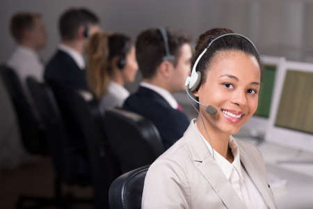 operator: Smiling woman with headset working at telemarketing