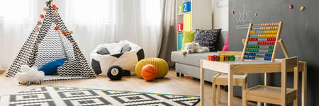bean bag: Bright child room interior with couch, bean bag chair and small teepee