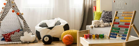 teepee: Child room with toys, balls, teepee on the floor and colourful abacus Stock Photo