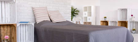 natural materials: Panorama of a modern bedroom arranged with natural materials and colours