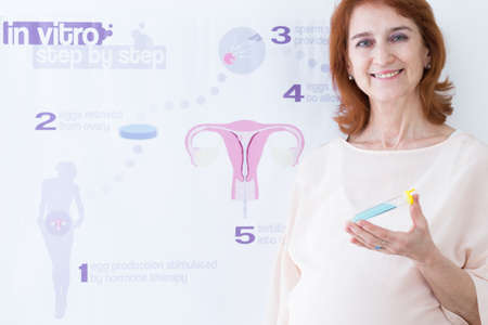 fertilisation: Pregnant woman with test tube and in vitro fertilisation infographic Stock Photo