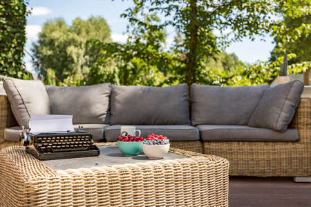 rattan: Image of an outdoor rattan sofa and coffee table Stock Photo