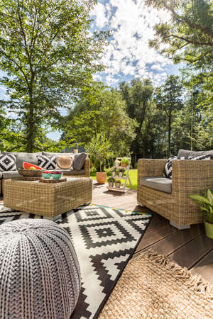 Image of rattan outdoor furniture set standing on a new patio