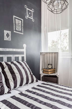 bedding: Contemporary bedroom with chalkboard wall, DIY nightstand and pattern bedding