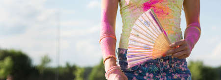 messed: Shot of a woman with a fun and clothes messed by coloured dye