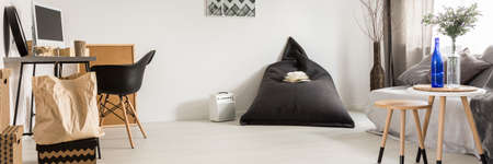 bean bag: Minimalistic room interior with work place and bean bag chair Stock Photo