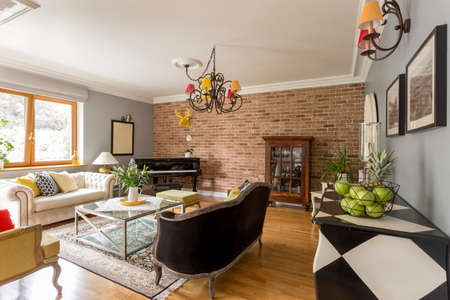 red brick: Creative stylish living room with trendy red brick wall Stock Photo